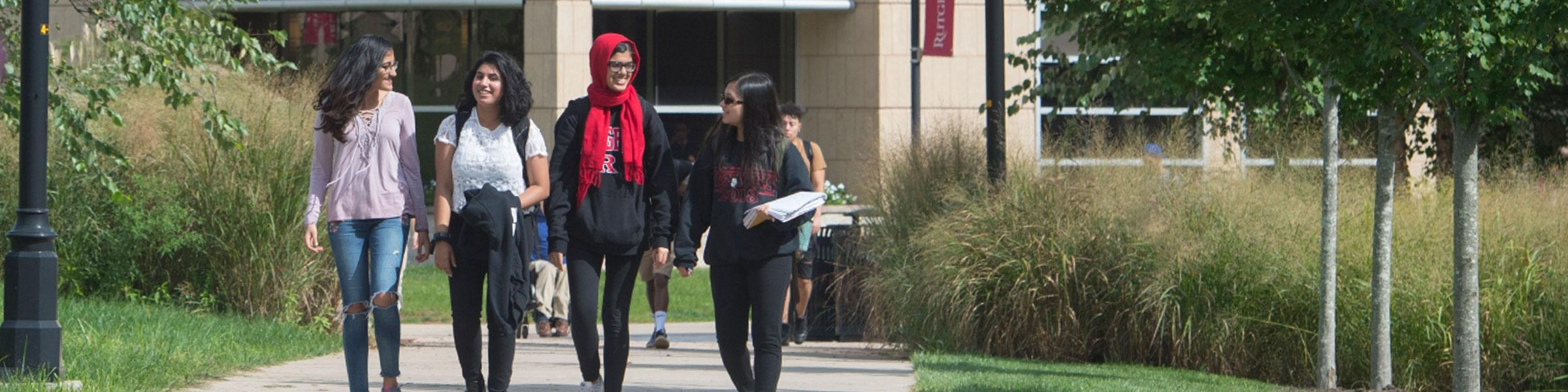 Four students stroll through Livingston campus.